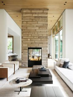 The interiors, which were designed by Philip Nimmo, feature a bright palette of rift-sawn white oak boards on the walls, floors, and ceilings, with black steel detailing and a stone that matches the exterior cladding.
