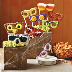 Who says you can't play with your food? Create edible masks with decorated shaped cookies and attach them to lollipop sticks with melted Candy Melts candy. Set up a photo station at your party, so guests can take pictures with their cookie mask creations before eating them.