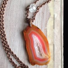 A Pink Agate Druzy Necklace with Crystal Quartz, Copper Chain, and Rock Crystal. A Long Gypsy Necklace with a Genuine Druzy Stone. So cool! From www.meyerclarkcreative.etsy.com