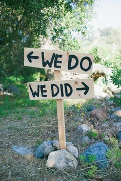 "Great signs for ceremony (""we do"") and reception (""we did"")."