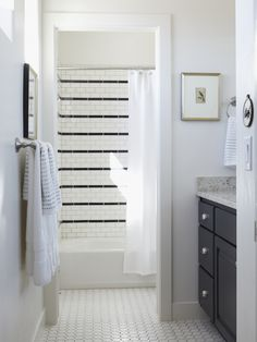 White subway tile with black stripes in the bathroom