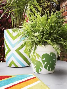 Give potted plants a facelift with just a little paint, stencils and tape. #hgtvmagazine http://www.hgtv.com/decks-patios-porches-and-pools/how-to-spruce-up-a-back-porch/pictures/page-8.html?soc=pinterest