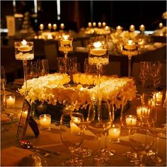 This center piece is more simple and really sets the mood. Love this idea as well.