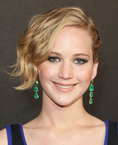 "Jennifer Lawrence's once dramatic pixie has officially entered bob territory. To avoid the awkward growing out process like Lawrence, celebrity hairstylist Chris McMillan recommends a trim every 10 weeks. ""Cut the back and the bangs, shaping hair into a bob as the sides catch up in length,"" he says."