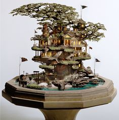 Japanese artist Takanori Aiba  It's no wonder a former maze illustrator is the architect behind these incredibly detailed bonsai sculptures made of clay, epoxy putty, copper line, plastic, and resin.