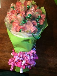 Strawberry belt flowers and sour patch watermelon buds in a bouquet -  great for birthdays and graduations