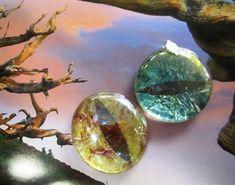 Reptile/dragon eye tutorials: glass floral weights + nail polish + tinfoil back + black paper iris. SUPER easy.