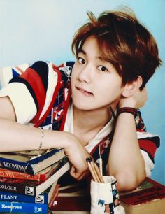 This is how I imagine him if a cute girl was tutoring him. Aw BaekHyung why so adorable?