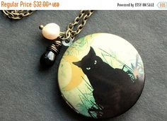 EASTER SALE Black Cat Locket Necklace. Cat Necklace with Black Teardrop and Fresh Water Pearl. Handmade Jewelry. by StumblingOnSainthood from Stumbling On Sainthood. Find it now at http://ift.tt/1RwYf4H!