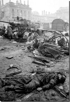 A dead German soldier lies amongst the graveyard of German military vehicles. Battle of Berlin. Nagasaki, Hiroshima, German Soldier, German Army, Military Photos, Military History, World History, World War Ii, Berlin 1945