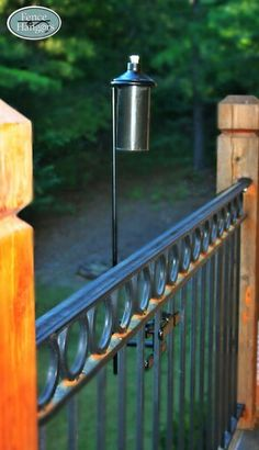 Tiki Torches By Fence Hangers Plants Landscapes And