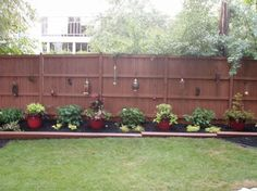 Outdoor Landscape :: Hometalk Can combine this with wine bottle tiki torches and put solar lights in some lanterns