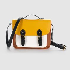 Mademoiselle R multi-coloured satchel.Outer: 100% synthetic polyurethane.Lining: 100% cotton.Fastening: 2 magnetic press-studs.Pockets: 1 zipped pocket and 2 mobile phone pockets.Size: L 25 x H 19 x D 5 cm.Adjustable shoulder strap with metal buckle fastening
