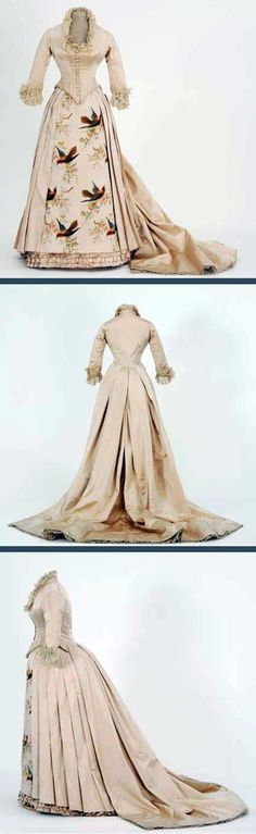 Bustle dress, Mary G. Worley, St. Paul, MN, 1880s. Ivory satin with a front panel of woven velvet flowers and birds. Minnesota Historical Society