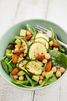Skin Beauty Salad  (serves 2)    230g cooked chickpeas (or use 1 tin)  2 big handfuls of baby spinach leaves  1/2 avocado, diced  1 small handful of almonds, soaked in water overnight  1 zucchini, sliced into 1/2 cm disks  olive oil, for brushing  2 tablespoons unhulled tahini (or use this recipe)  1/2 lemon, juiced  water  pinch of salt  1 small garlic clove  freshly ground black pepper