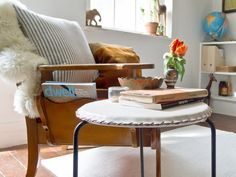 Great DIY for a modern space: a whipstitched leather cover for a vintage stool.