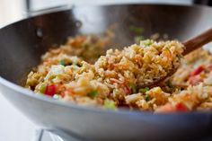 This dish is loosely based on Thailand's ubiquitous fried rice dish, kao pad Usually some kind of animal protein accompanies the rice — squid, crabmeat, ham, chicken, whatever the cook has on hand My version relies instead on tofu and vegetables; the most important ingredients are the rice itself, the garlic and the fish sauce