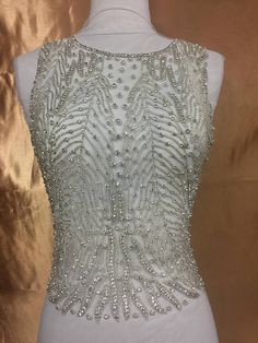 Vintage Inspired, Great Gatsby, elegant bridal applique. Stunning large rhinestone beaded appliqué; adorned with detailed beading and quality rhinestones, creating a rich pattern that is both glamorous and elegant. This piece is a full bodice applique.  Add to your perfect gown or create your own gorgeous dress with this glamorous piece.       Price Breakdown:   1 Piece $95.00 | Shop this product here: http://spreesy.com/RhinestoneClub/74 | Shop all of our products at…