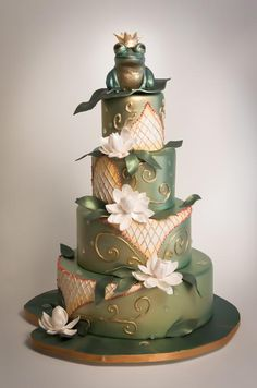 For a fairy tale-inspired wedding, a pearlescent frog prince awaits atop a water lily-covered cake by sugar couture.