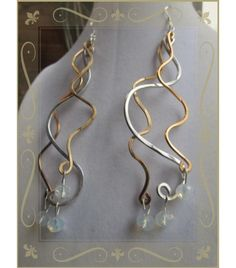 Long, silver & gold dangles on .925 sterling ear wires $15.00