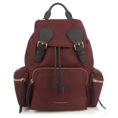 Burberry Medium nylon backpack (€930) ❤ liked on Polyvore featuring bags, backpacks, red, quilted nylon backpack, zip backpack, quilted backpack, nylon bag and quilted nylon bag