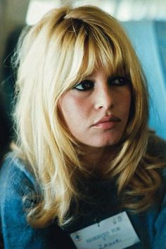 Bridgette Bardot rocking her classic look of heavy fringe and even heavier eyeliner