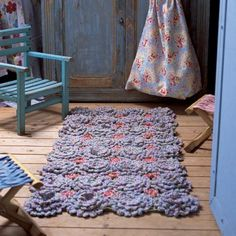 Crocheted bedroom area rug. Picture only, you must have a magazine subscription for pattern. But you could improvise, right?