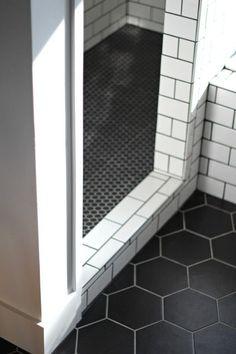 Terrific Transitions: 10 Inspiring Floor Installation Design Ideas. Cool bathroom black and white tile.