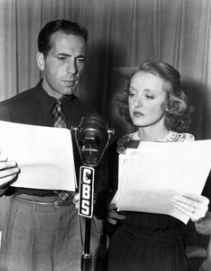 """""""Humphrey Bogart and Bette Davis taking part in the USO Command Performance to keep up public morale for the war, 1943."""""""
