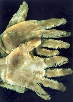 Human Skin Gloves made by serial killer Ed Gein -- Gory and horrific, which of course translates to good story material. it truly is horrifying.