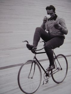 Black & White - Multi-tasking:  Drinking his tea while reading his paper and riding his bike.