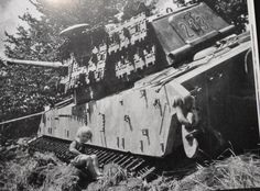 Children playing on a Tiger II, which was abandoned after it became stuck.