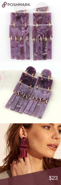 Acrylic Fringe Chandelier Earrings - Purple A pair of earrings that are all about movement! Beautiful geometric shapes in a marbled acrylic material. Arranged with stunning fringes at the bottom. Pushback earrings. Materials: Acrylic Resin, Zinc Alloy. Approximately 3 inches long. Atelier Sona Jewelry Earrings