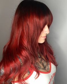Look at that red shine! This is a re install on @carolyn_elaine_tattoo hair extensions.  I customize the color especially for her! We added a new bang to her doo! She looks so #sexy! #hairextentions #dreamcatchershairextensions #joicointensity #rootshade #colormelt #redhead #longhair #shinyhair #beautiful #inkmaster