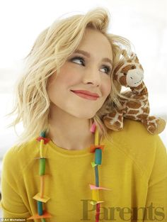 At work and play: Kristen Bell snuggled up to a toy giraffe while chatting about teaching her daughters how to be charitable in the November 2016 issue of Parents magazine