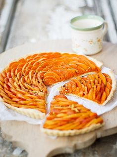 Apricot tart --could be made raw by marinating the apricot slices in honey lemon juice and orange zest