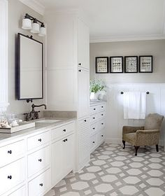 Gray bathroom with white cabinets and oil rubbed bronze fixtures and hardware