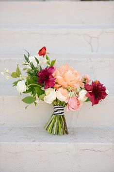 lush asymmetrical bouquet featuring peonies, garden roses and ranunculus by Southern Table