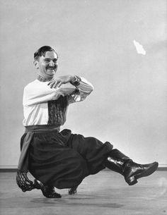 The Russian Cossack dance, aka the Kazachok or Kozachok dance, Hopak dance, or squat dance.