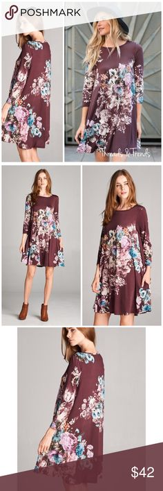 Burgundy Floral Tunic Dress Stunning Autumn color burgundy with a bouquet of floral print. Made of ran and spandex. Sizes S, M, L, XL Threads & Trends Dresses