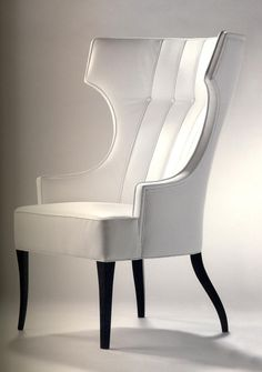 Bergere Pouff (Versace): The alternate use of black and white on clean, linear shapes creates an attractive ambience.