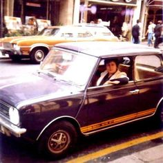 Fan snapshot of Marc Bolan in the passenger seat of his purple Mini, 1976... the same car he would perish in a year later.