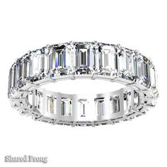 This Emerald Cut Diamond Eternity Band is a pristine presentation of one's sincere, honest vow of commitment renewed as an anniversary gift idea. 6.00 cttw in F-G color VS clarity emerald cut diamonds comprise this eternity band with their seamlessly perfect appearance owed to their step-cut faceting. Set in your choice of a four prong or shared prong setting, this elegantly beautiful statement of your love is available in platinum or 14kt or 18kt gold and in white, rose, or yellow colored…
