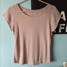 Festival tee Dusty rose festival tee from American Eagle. Looks like a short sleeve baseball tee. The shirt is cotton & sleeves are chiffon. Good condition. American Eagle Outfitters Tops Tees - Short Sleeve