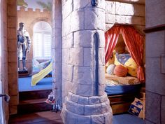 Made for a future king or queen, this fantasy-come-true bedroom comes equipped with a suit of armor, castle walls, an indoor slide and a private bed chamber.