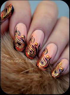 Paisley painted fingernail tips. The art work is stunning on these nails, not something that can taught so I appreciate this beauty that much more.