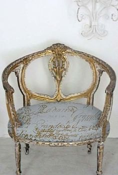 gold chair. I wouldn't sit on this cuz it doesn't look comfortable, but it sure is 'purdy', isn't it?