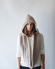 Chunky Hooded Cowl Infinity Scarf- I think I could figure out how to make this... I bet the cowl part it just the scarf sewn up in the back... I'd just need to figure out what stitch she used. It is beautiful!