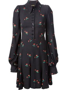 Navy blue cotton cherry print dress from Biba featuring a front button fastening, a fitted waist, bell sleeves, button cuffs and a pleated skirt.