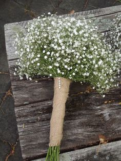Rustic wedding bouquet for bride of babys breath bound in hessian